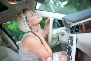 woman driver cooling herself with blowing from air conditioner in the car